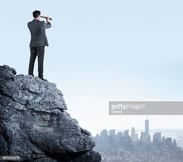 Businessman Searching Through Telescope
