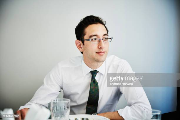 Businessman seated in cafe after eating lunch