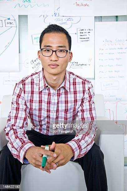Businessman seated with charts