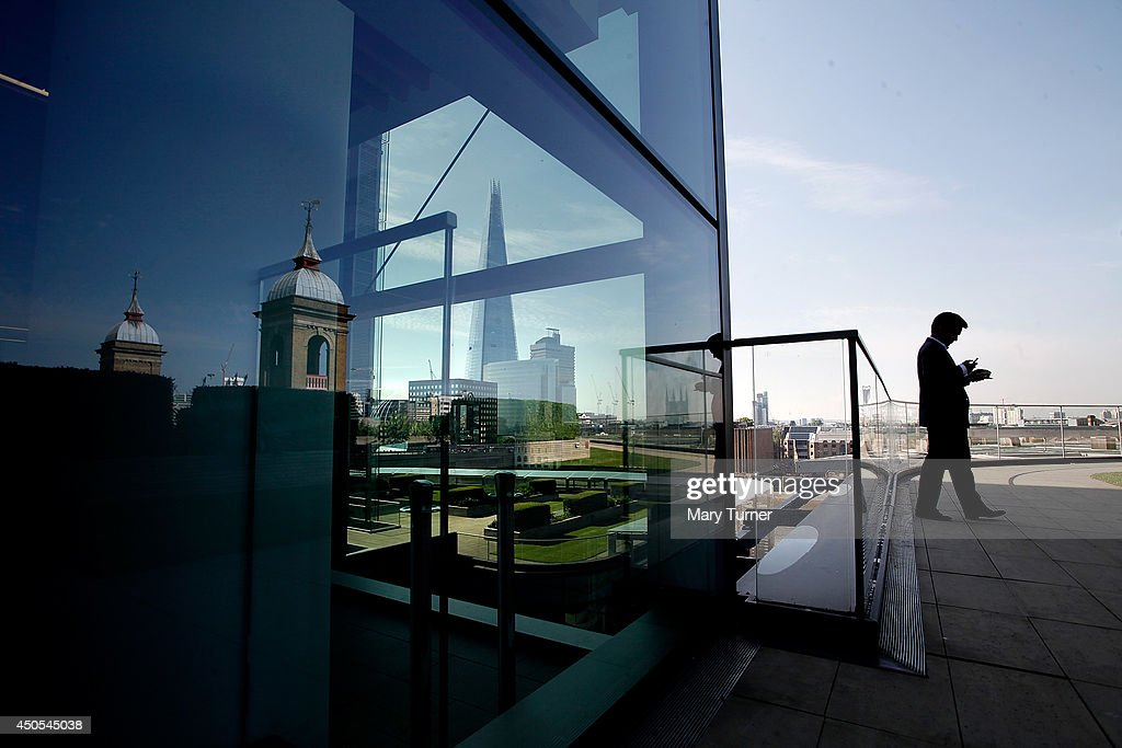 A businessman sends a text message from the Nomura rooftop gardens, which are opening to the public as part of Open Garden Squares Weekend 2014, on June 13, 2014 in London, England. Nomura's 6th floor terrace garden with panoramic views across the Thames is one of over 200 usually private gardens which members of the public will be able to explore between June 14th and 15th 2014.