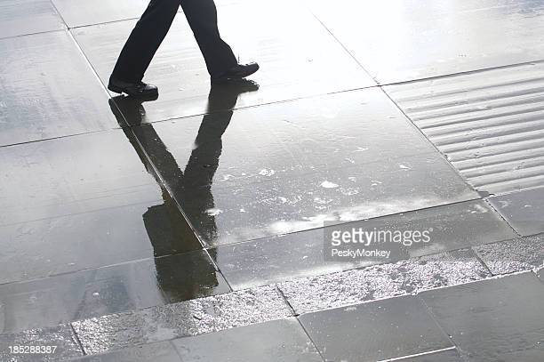 Businessman Shadow Reflects on Wet Stone Plaza