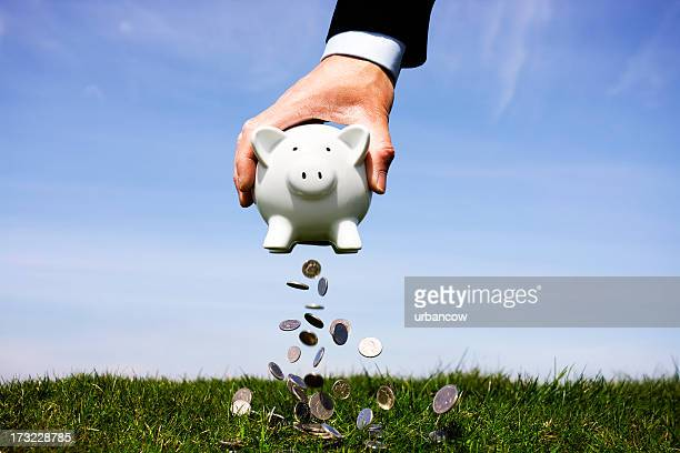 Businessman shaking a piggy bank