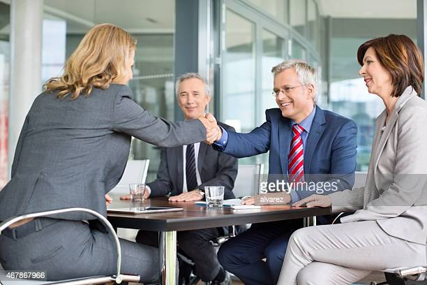 Businessman shaking hands with a colleague in meeting