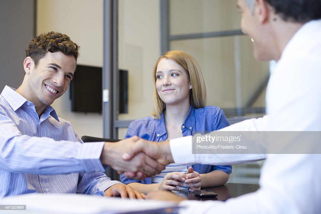 Businessman shaking hands with client in meeting