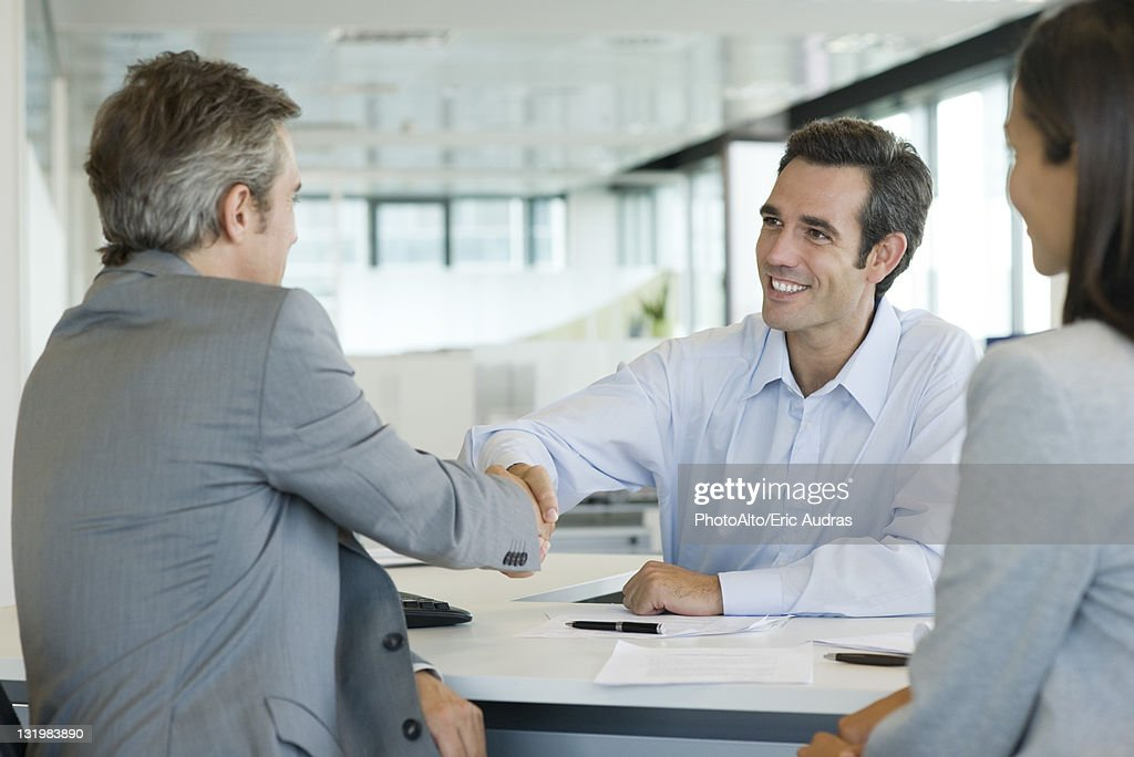 Businessman shaking hands with client : Stock Photo