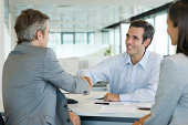 Businessman shaking hands with client