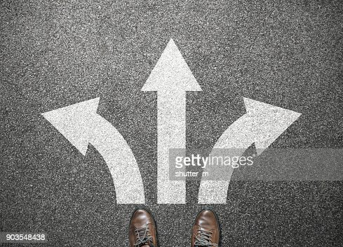 businessman shoes stand at junction, choose way to success : Stock Photo