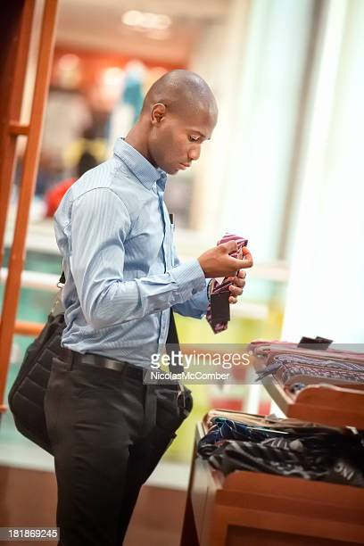 Businessman shopping for ties profile
