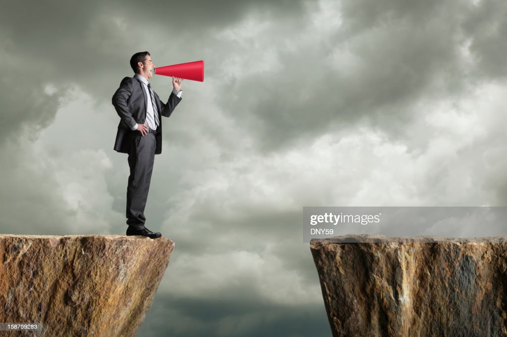 Businessman Shouting Into Megaphone : Stock Photo