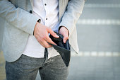 businessman show his empty wallet on street