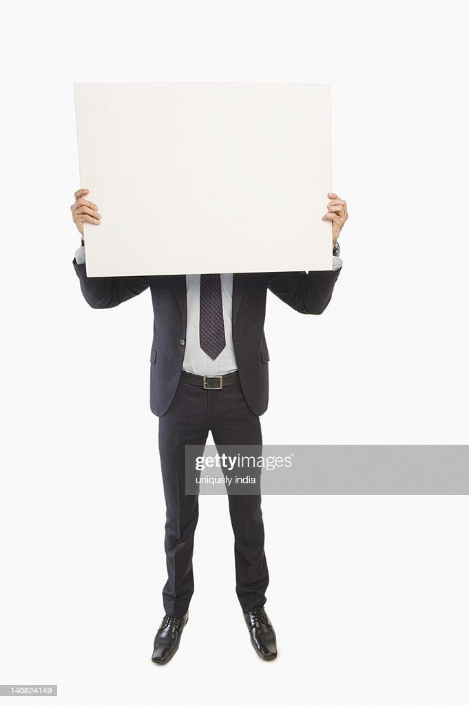 Businessman showing a blank placard : Stock Photo
