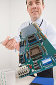 Businessman showing a computer circuit board