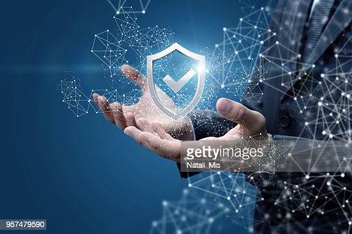 Businessman showing a shield with a check mark. : Stock Photo