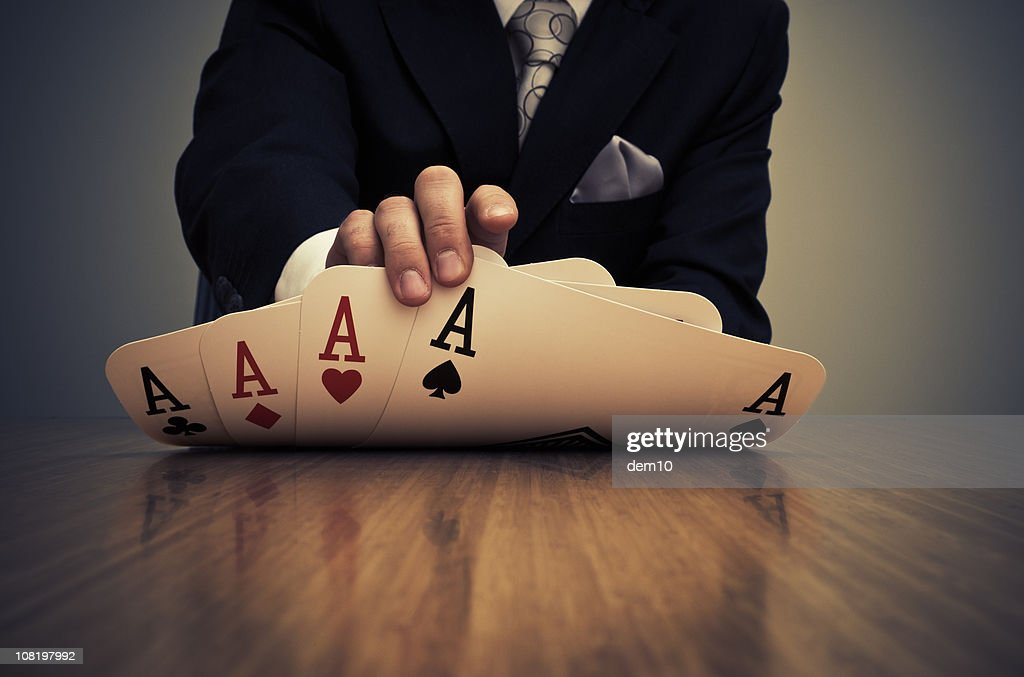 Businessman Showing Card Hand of Aces : Stock Photo