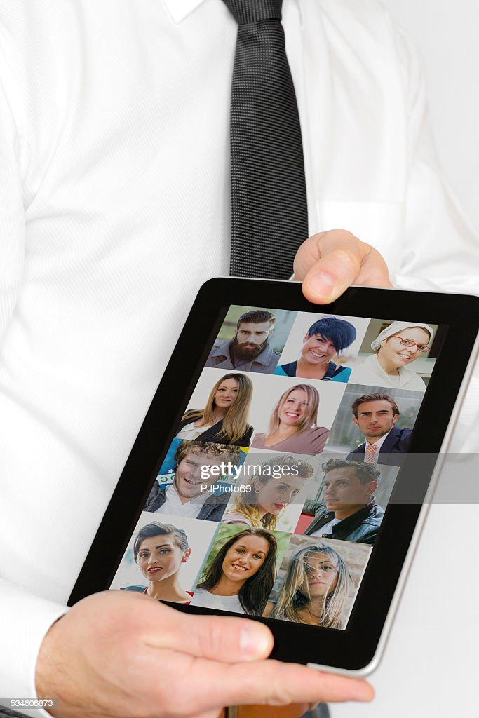 Businessman showing digital tablet with customers picture's