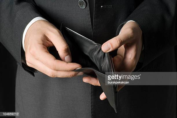 Businessman showing empty wallet