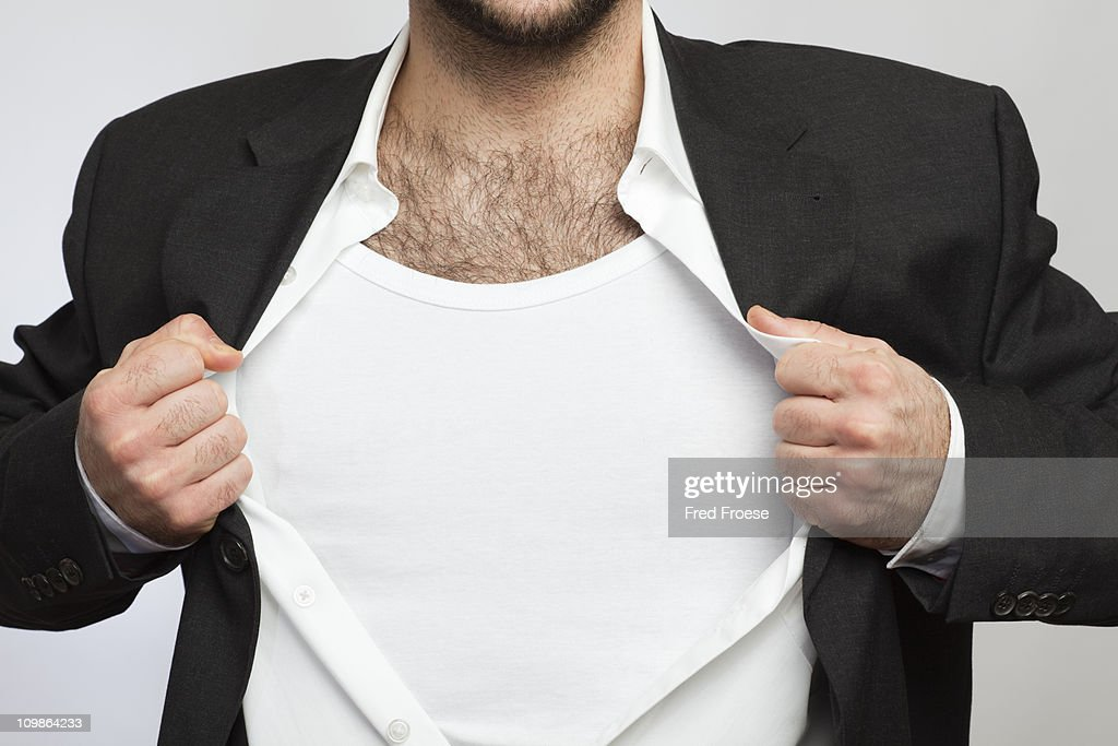 Businessman showing his chest