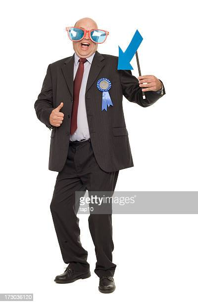 Businessman showing off with ribbon