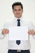 Indian businessman showing blank placard