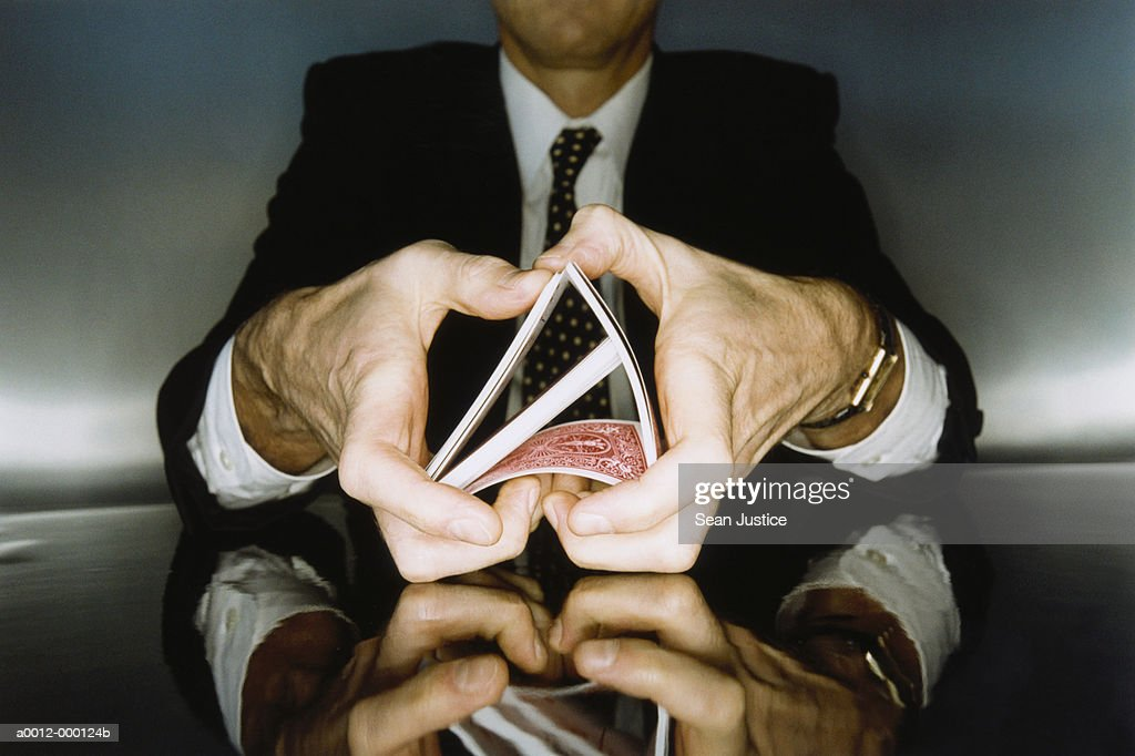 Businessman Shuffling Cards : Stock Photo