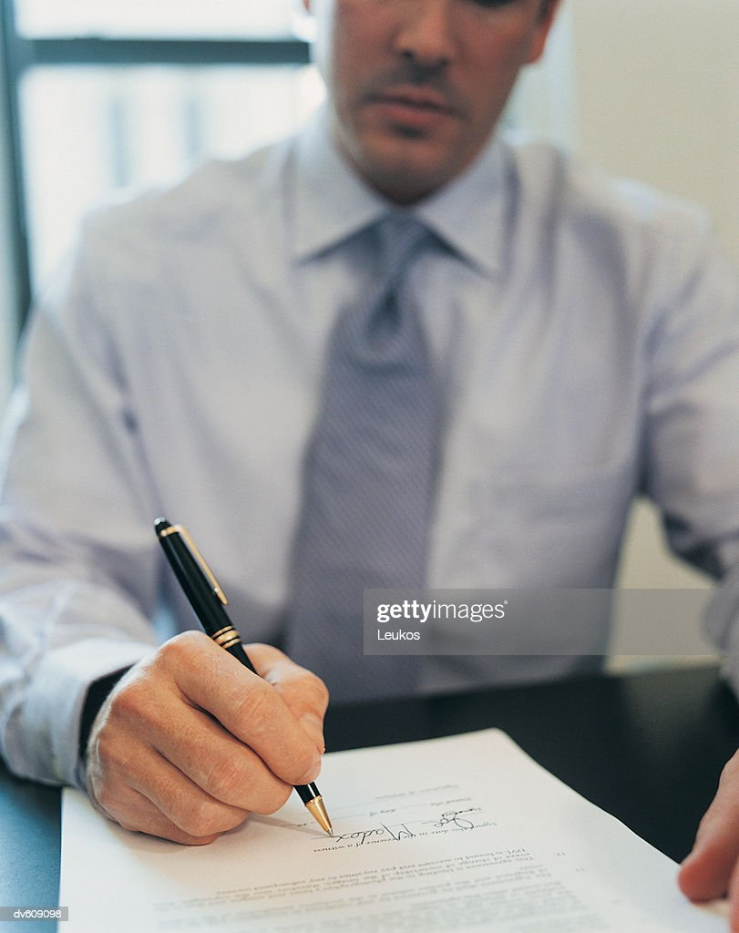 Businessman Signing Letter : Stock Photo