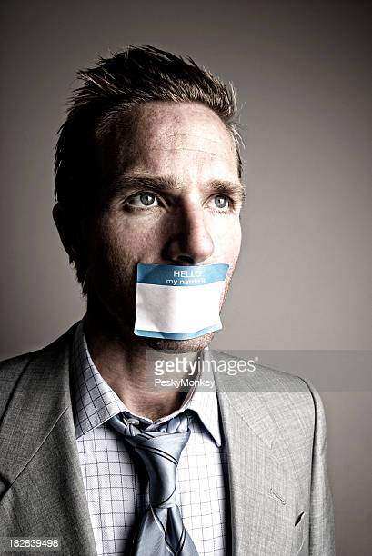 Businessman Silenced by Name Tag