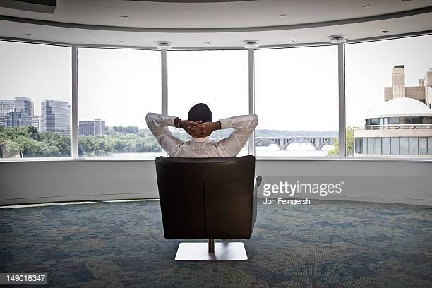 Businessman sitting alone in open room