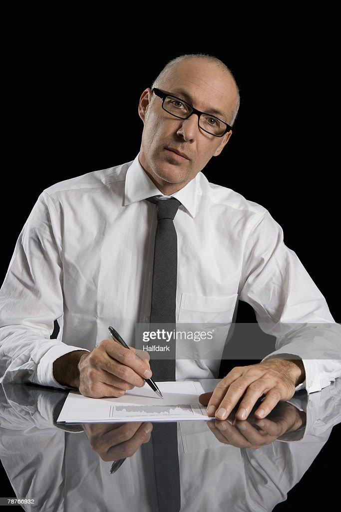 A businessman sitting at a desk