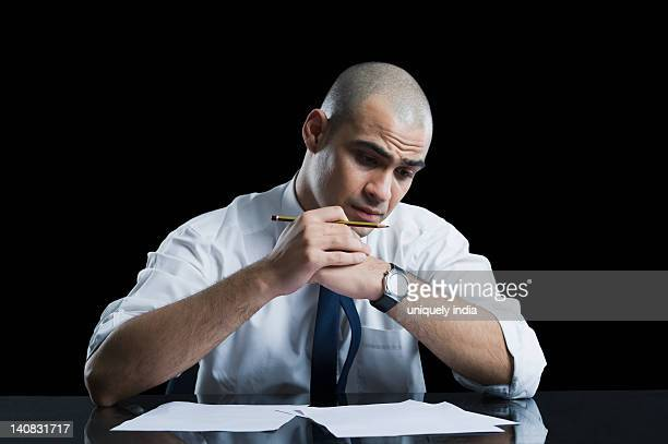 Businessman sitting at a table and thinking
