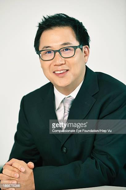 Businessman sitting at desk, close up