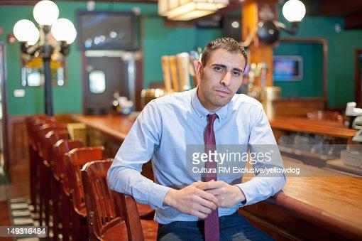 Businessman sitting at empty bar : Stock Photo