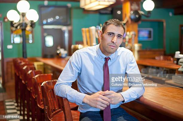 Businessman sitting at empty bar