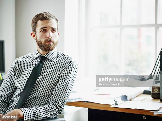 Businessman sitting at office workstation