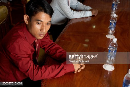 Businessman sitting at table : Bildbanksbilder