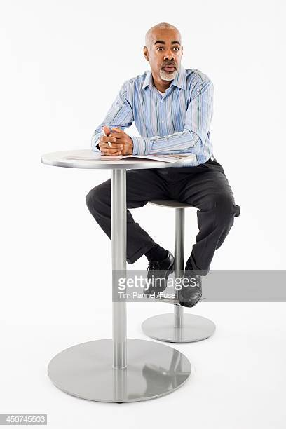 Businessman Sitting at Table