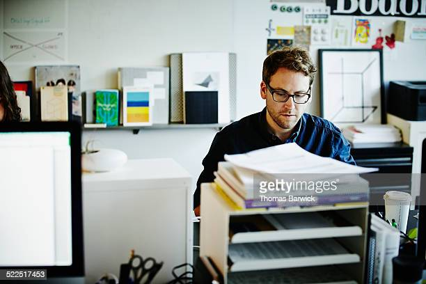Businessman sitting at workstation in office