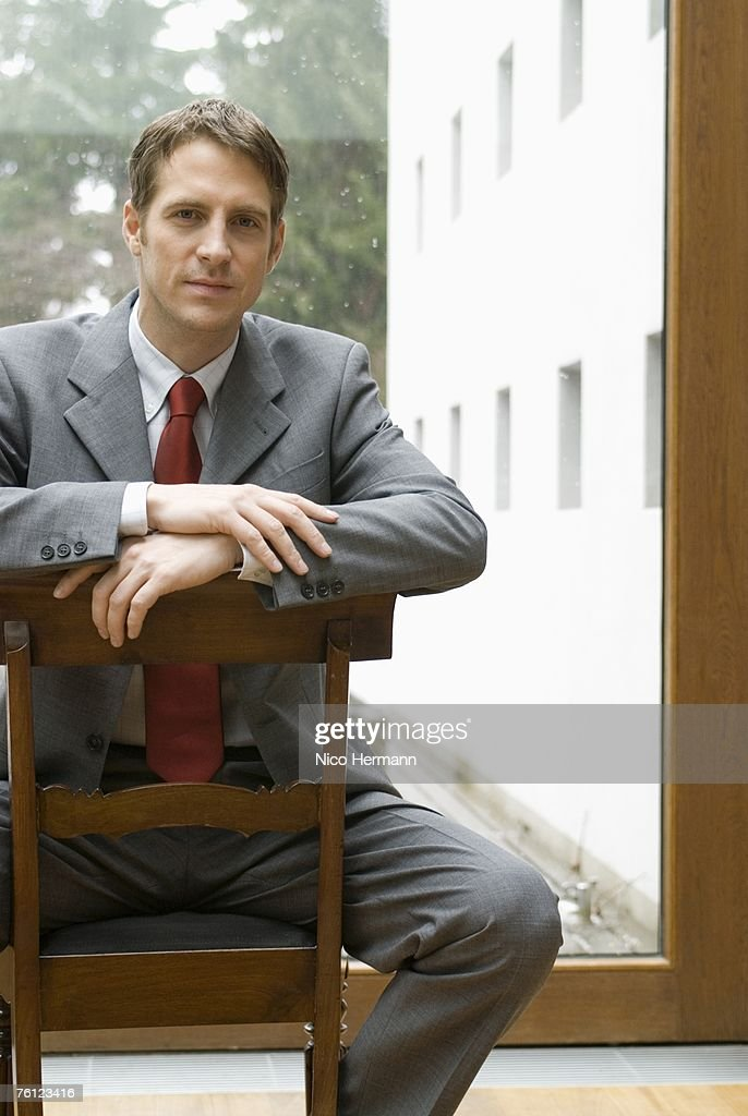Businessman sitting on chair, portrait