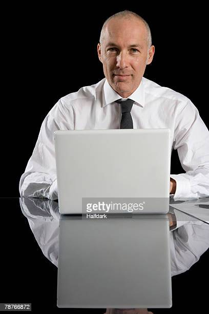 A businessman sitting behind his laptop