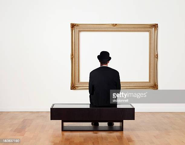 Businessman Sitting in a Art Gallery