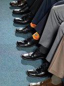 Businessman sitting in a row
