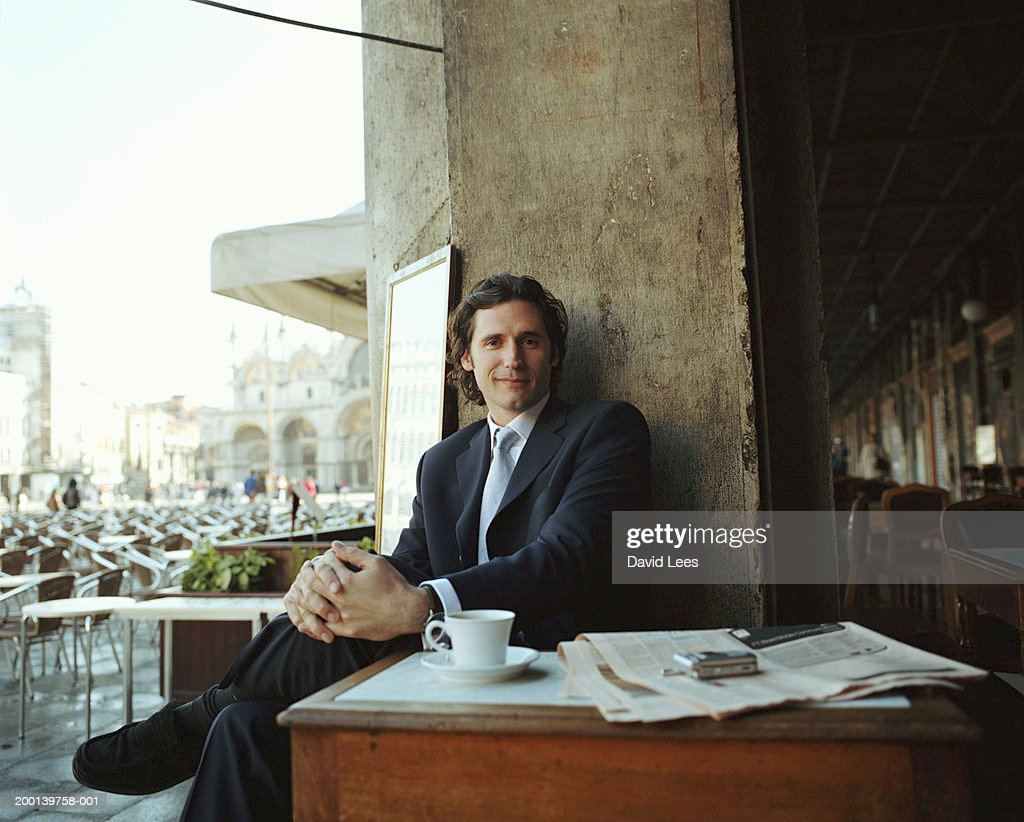 Businessman sitting in cafe, portrait
