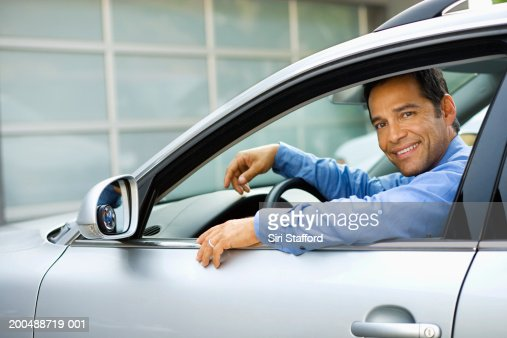 Businessman sitting in car : Stock Photo