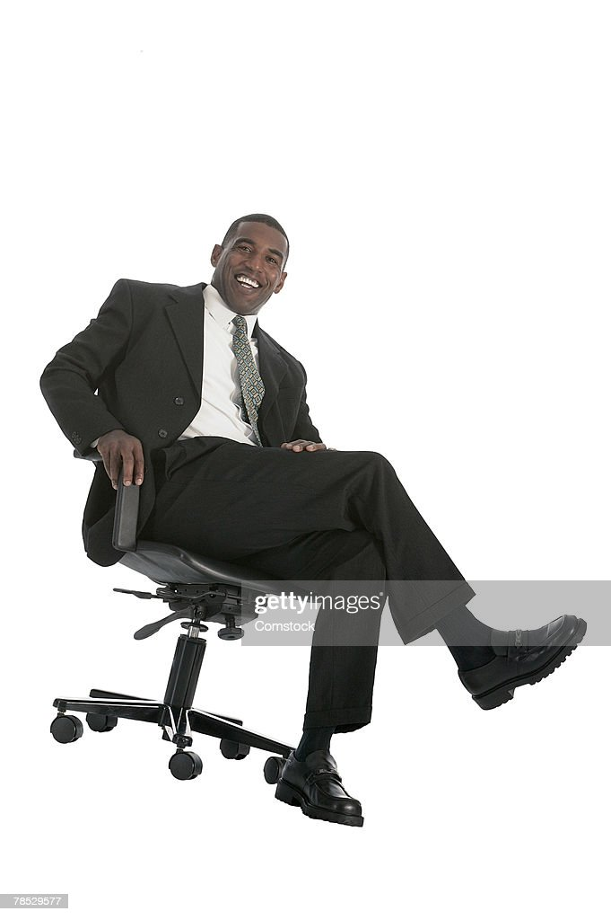 Businessman sitting in chair : Stock Photo