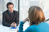 Businessman sitting in front of a businesswoman