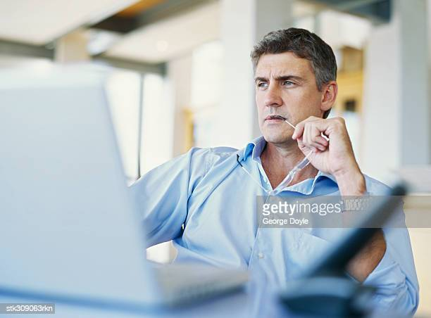 businessman sitting in front of a laptop in an office