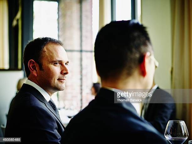 Businessman sitting in meeting at restaurant