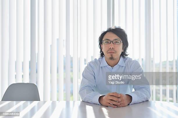 Businessman sitting in meeting desk