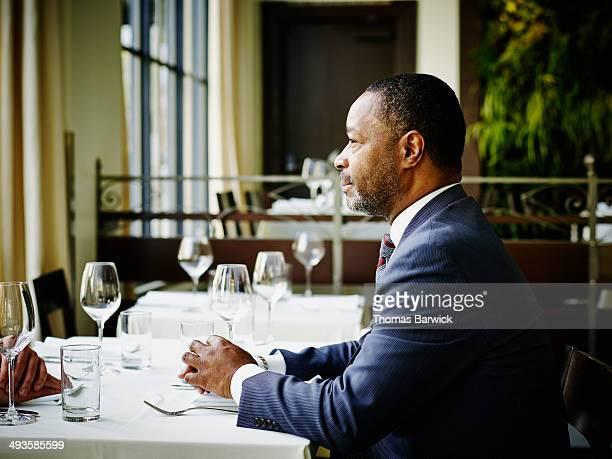 Businessman sitting in meeting in restaurant