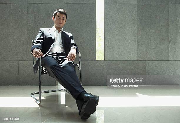 Businessman sitting in modern seat