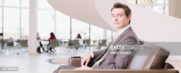 Businessman sitting in office waiting area
